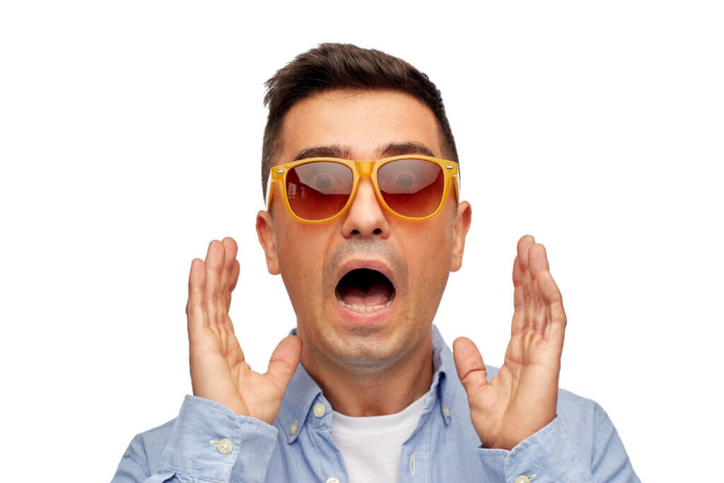 summer, emotions, style and people concept - face of scared middle aged latin man in shirt and sunglasses